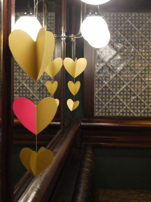 A pop of neon pink to our gold hanging heart decorations at Chaakoo in Glasgow  Luxury decorations by Paper Street Dolls  Check out our store - paperstreetdolls.etsy.com