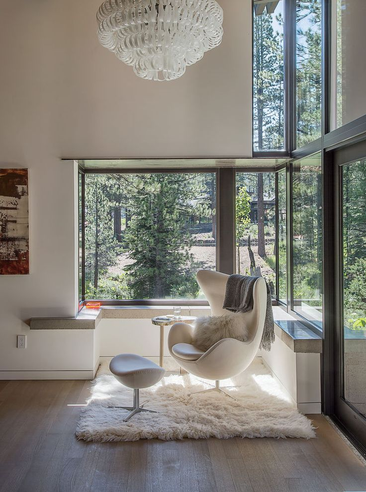 Love the monochromatic interior and those windows!  I would love to sit there!