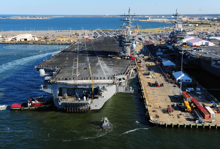 NORFOLK (Dec. 19, 2012) The Nimitz-class aircraft carrier USS Dwight D. Eisenhower (CVN 69) makes its approach pierside at Naval Station Norfolk. Dwight D. Eisenhower returns to Naval Station Norfolk after a six-month deployment to the U.S. 5th and 6th Fleet areas of responsibility in support of Operation Enduring Freedom, maritime security operations and theater security cooperation efforts. (U.S. Navy photo by Mass Communication Specialist 3rd Class Kevin J. Steinberg/Released)