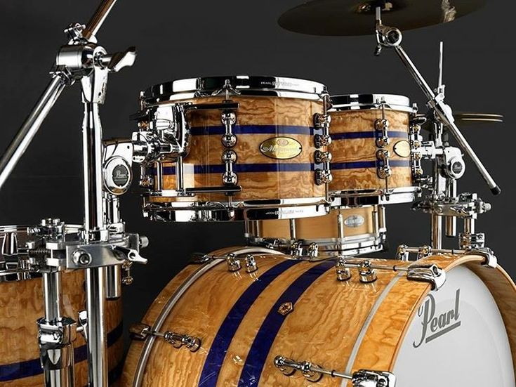 This Masterworks Series in Natural Tamo with Blue Stripes has a 22x17 bass drum, 10x7, 12x7 toms, & 16x16 floor tom.