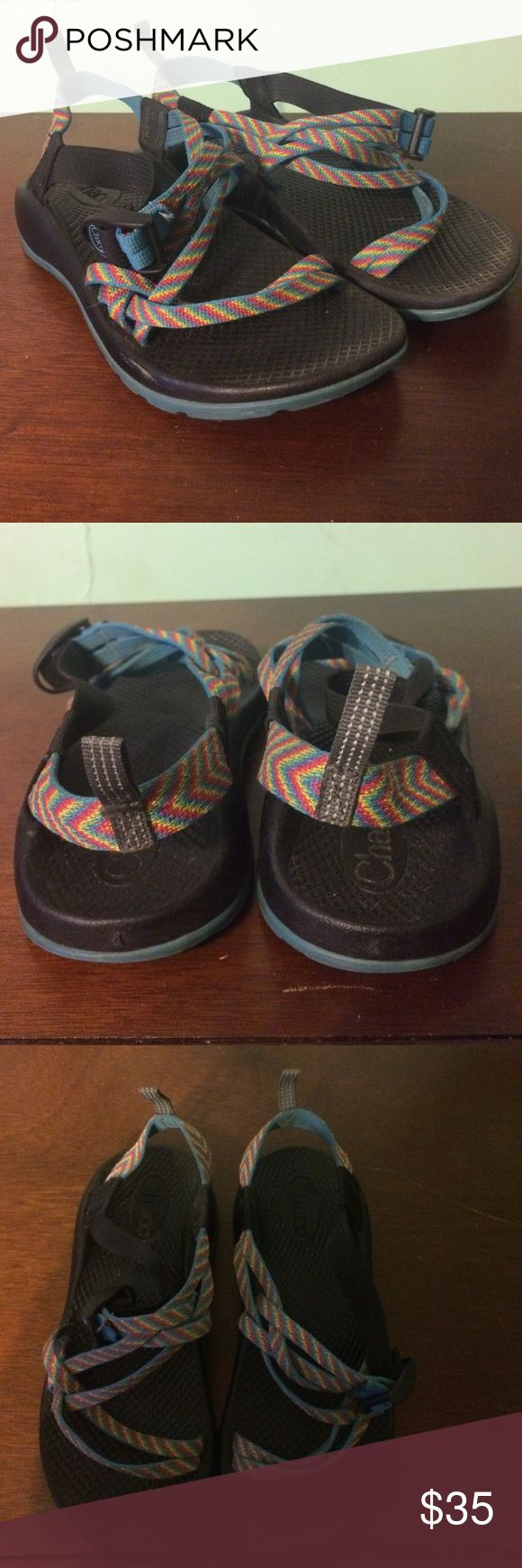Size 4 youth / 6 in woman's Chacos rainbow colored Chaco sandals, rainbow colored and has loops at the end to easily carry anywhere. Going on vacation this winter? These are must have sandals! Enjoy! Chacos Shoes Sandals