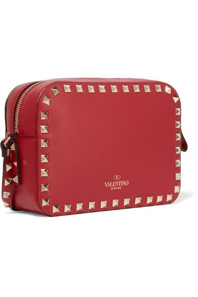 Valentino's shoulder bag is crafted from smooth red leather and hand-embellished with the label's signature 'Rockstuds' - each one galvanized so they'll stay glossy and gold. It's lined in durable canvas and is perfectly sized to hold your cell phone, keys and cards. Adjust the strap to wear it cross-body.