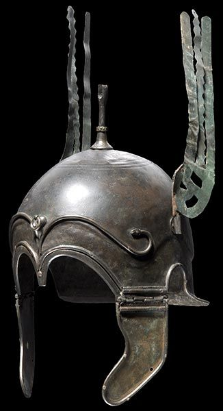 "A bronze helmet of Chalcidian style from late 4th cent. B.C. ~ probably Celtiberian, though I've seen some with those distinct ""eyebrows"" listed as Greek or Italian. This is a style that originated in Greece and probably came to Iberia and Italy through the various Greek colonies in both those lands."