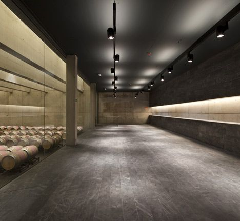 A sandstone winery that is partially submerged in the ground.