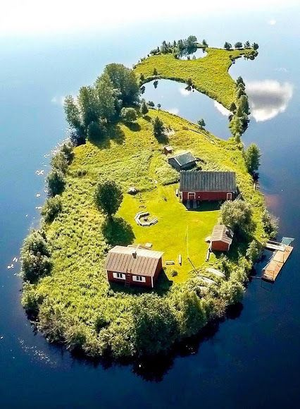 A small island in Rovaniemi, Finland. Within Finland's borders there are 789 islands of over 1 km2 area