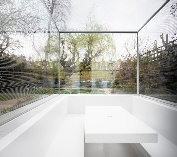 White on White, London - Gianni Botsford Architects.  Subtle details on the glass control your views into the garden outside.