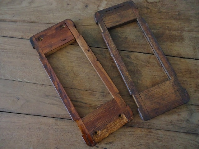 using part of the old sewing machine drawer holders--lovely old wood