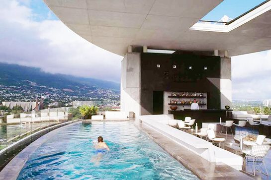 9 jaw dropping hotels you can actually afford travel - Hotel new york swimming pool roof ...