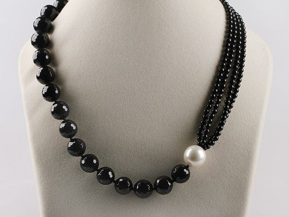 Necklace inspiration. Half large beads, half multi strand, joined by large contrasting bead or pearl