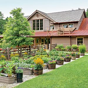 The Organic Chef's Garden -- love the fish tub planters and half whiskey barrels.