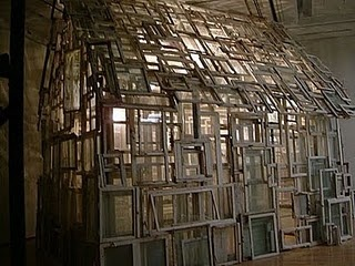 I love the idea of using old windows to create such a lovely structure!