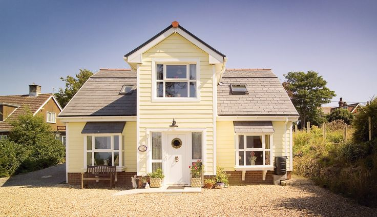 Both real wood and clever man-made lookalikes can give a house a traditional UK vernacular style or a New England look, or be used for a more contemporary appearance