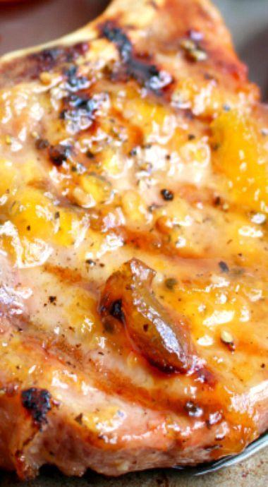 Apricot Glazed Grilled Pork Chops: I used some homemade peach jam, Italian salad dressing and a little Dijon mustard. Mmmmm........10/10