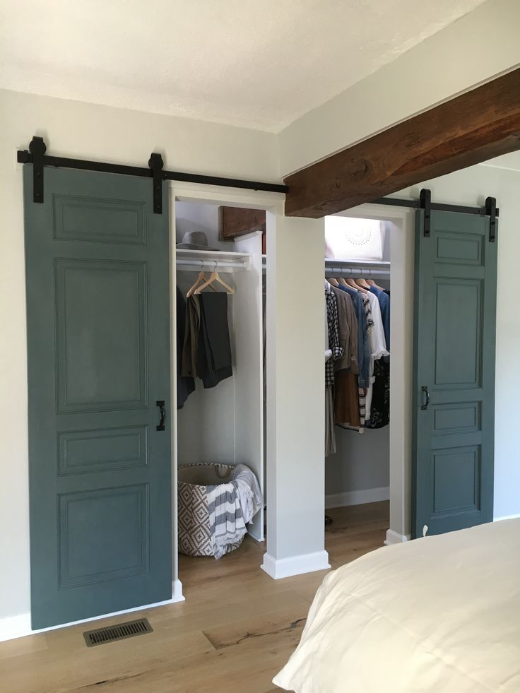 Found antique doors repurposed for barn door closet sliders.  Stone House Revival - Season One.