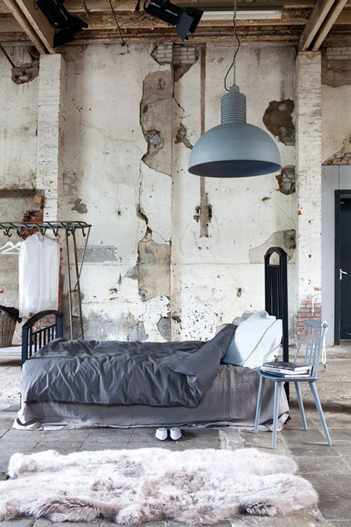 Studio apartment with exposed beams and stone. This space looks like a safety hazard, but I absolutely love it!
