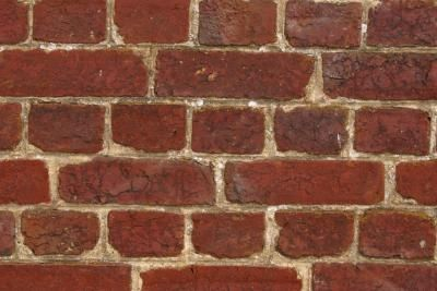 How to Fill in Cracks Between Cement Steps on a Brick House