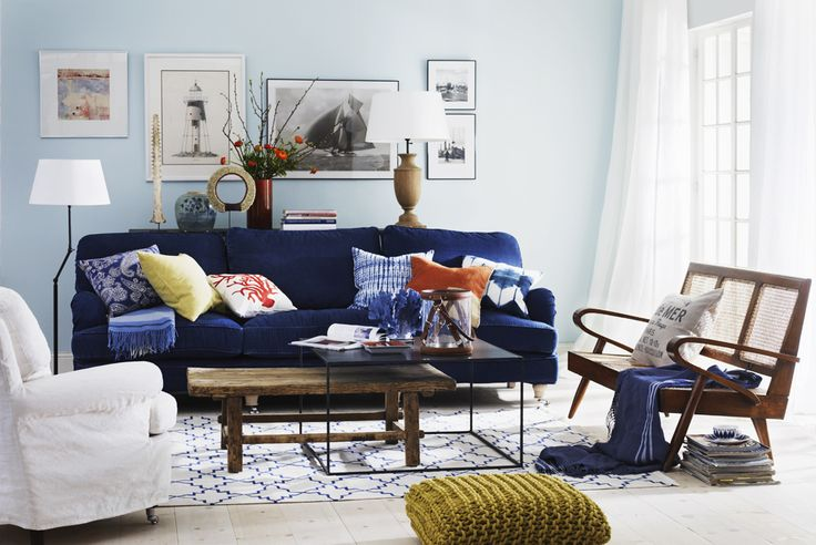 blue sofa, mixed coffee tables