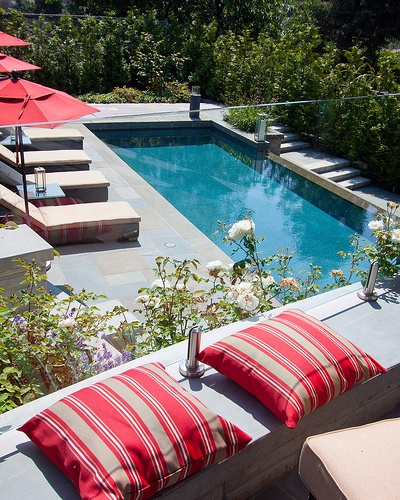"ALKA POOL - This terraced patio is the ideal location for a ""just because"" summer party."