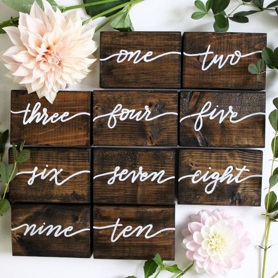 **Gold paint option now available! Please select white or gold when purchasing!**  A beautiful addition to any wedding or event, these wood block table numbers compliment rustic, vintage, and modern decor. These double-sided wood blocks measure 3.5x5. Wood blocks have been stained and hand-painted by me. Holes and imperfections in the wood add character and each one is meant to be different and unique.  These may be purchased individually, as many as you need for your event.  $8 per block…