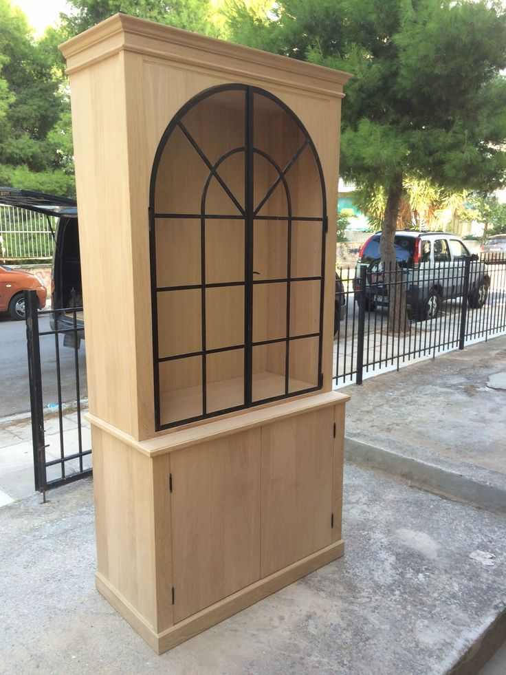 Oak with curved iron doors