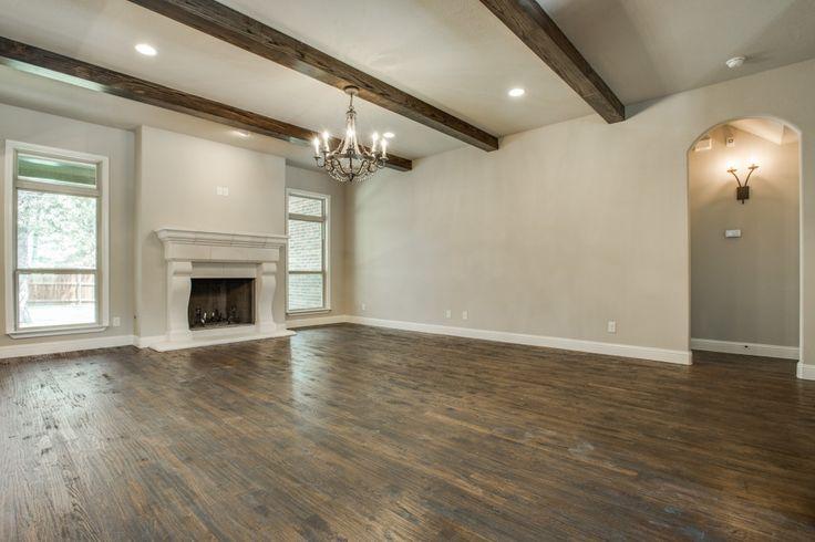Wood Beams. Faux Cast Stone Fireplace. Hardwood Floors. Bannister Custom Homes.
