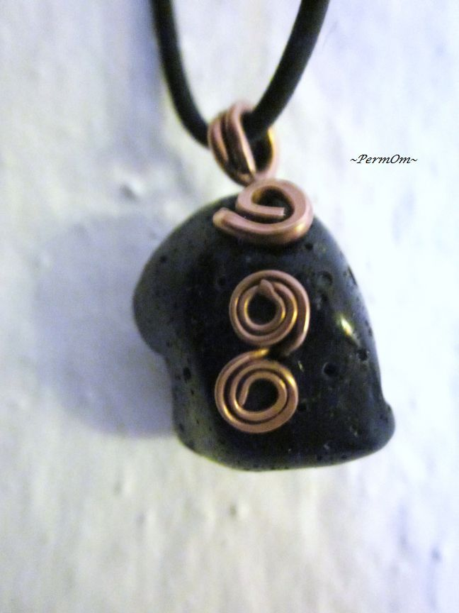 A very beautiful obsidian pendant with copper spirals and copper hook that blocks psychic attack and absorbs negative energies from the environment. It draws out mental stress and tension. It stimulates growth on all levels, urging exploration of the unknown and opening new horizons. Brings clarity to the mind and clears confusion. Helps you to know who you truly are.A strongly protective pendant, it forms a shield against negativity.