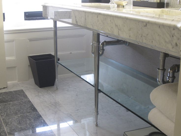Tapered Leg Model Shown In Polished Chrome Finish With Carrara Marble Sink Top And Glass Towel