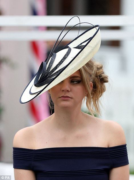 York races: Ladies Day sees glamorous ladies don rain macs | Daily Mail Online
