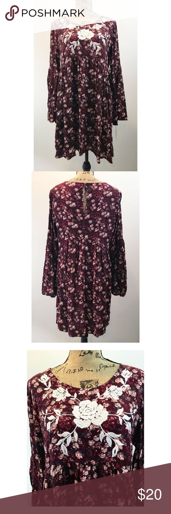 """NWT Xhilaration Plum Floral Dress NWT. Xhilaration. Xlarge. Also fits Large. Plum floral dress with embroidered flower detail. Key hole opening in back. Has crochet lace on the sleeves. B: 22.5"""", W: 23"""", L: 35.5"""" Xhilaration Dresses Long Sleeve"""