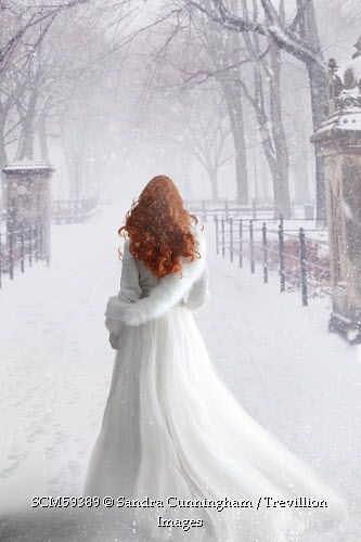 Trevillion Images - red-haired-woman-in-white-dress-in-snow