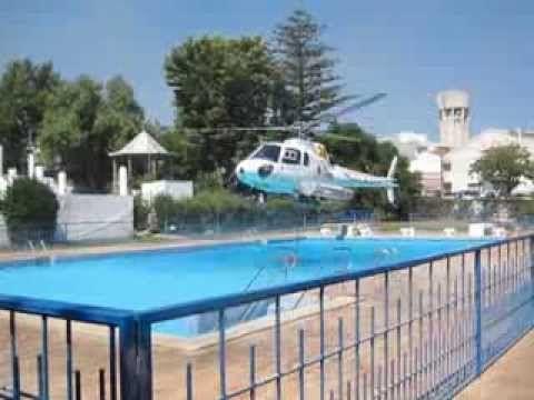 Helicóptero reabastece agua nas piscinas de S. Brás de Alportel  para co...