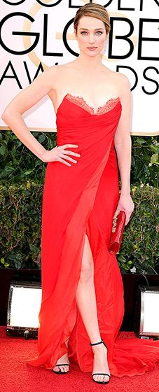 Kristen Connolly: 2014 Golden Globes Ravishing in red! The actress stunned in a strapless, lace-embroidered, sweetheart gown with a slit in front to reveal her legs. She paired her look with a matching clutch and black strappy stiletto sandals.