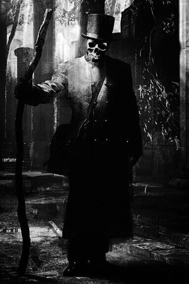 Baron Samedi, Vodoun loa, the lord and guardian of the cemetery, represented there by a large cross placed over the grave of the first man buried there. Important spirit  of the Bizango.