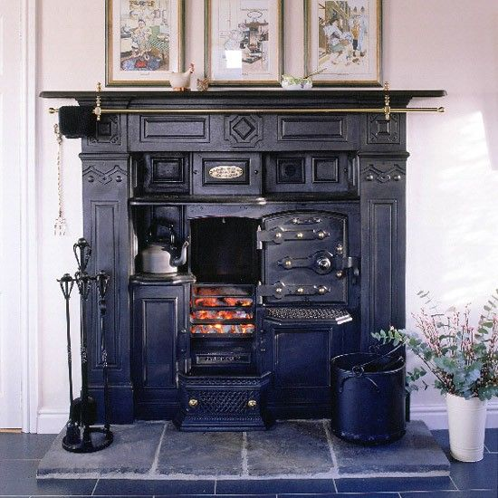 Victorian range in country kitchen - just love the idea of a working fireplace like this in a cabin.