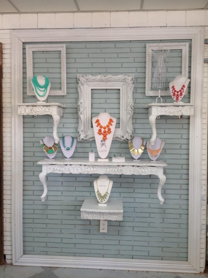 Love the all white props to help the colourful jewelry pop. Cool idea to mount light weight tables on a wall to bring the height of your display up. Could work in a craft fair booth.