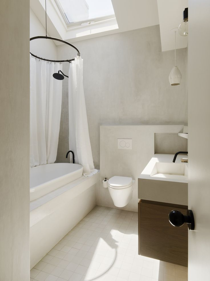white bathroom in brooklyn apartment with plaster concrete wall finish