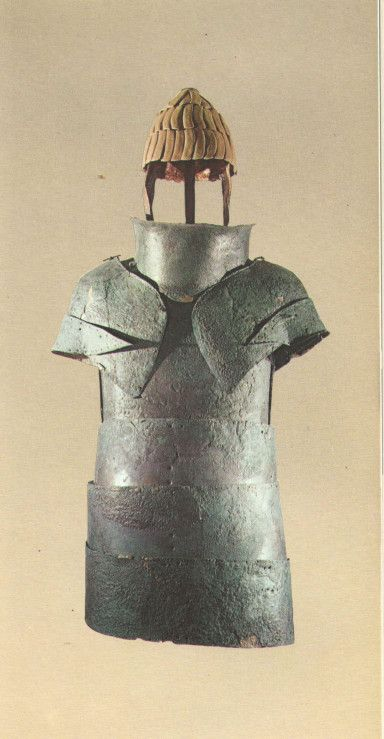 Sarpedon might have fought in a suit of bronze armor similar to this. The helmet pictured was made of boars' tusks.