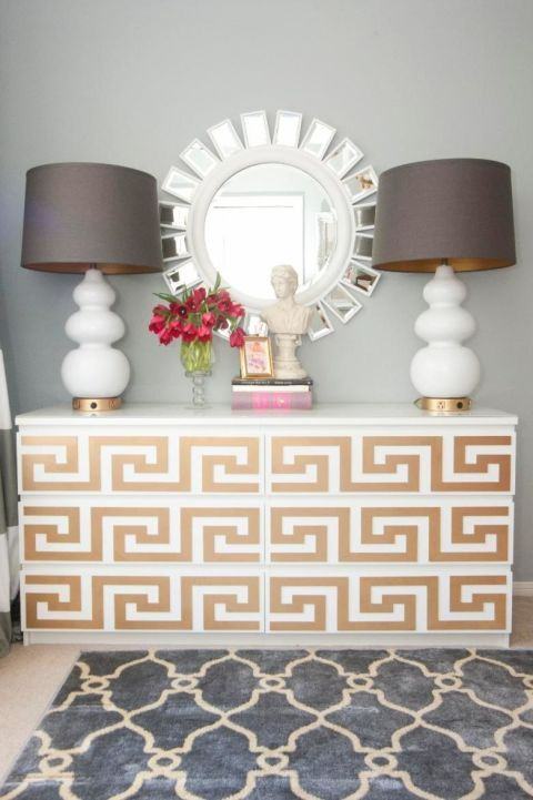 Stick-on overlays in a gold Greek key pattern give this white dresser a glamorous update without requiring a hammer and nails (meaning way less pressure if you don't like the final outcome). Click through for a tutorial and more IKEA hacks for the MALM dresser.