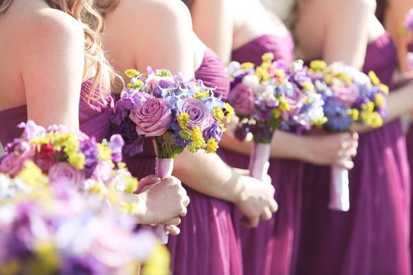 Add a few punches of yellow to a purple rose bouquet.Photo Credit: Allyson Wiley Photography