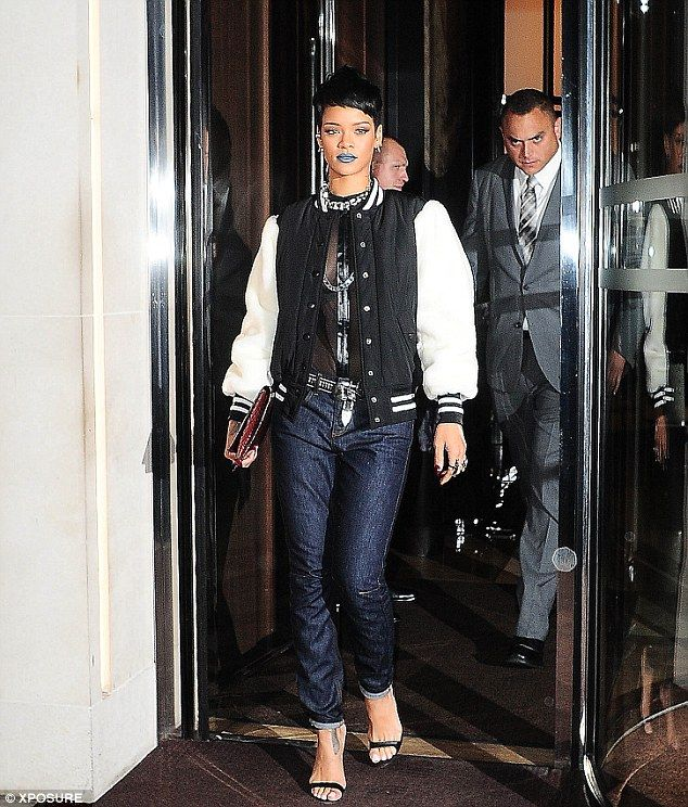 Rihanna paired a black and white varsity jacket with a see-through shirt
