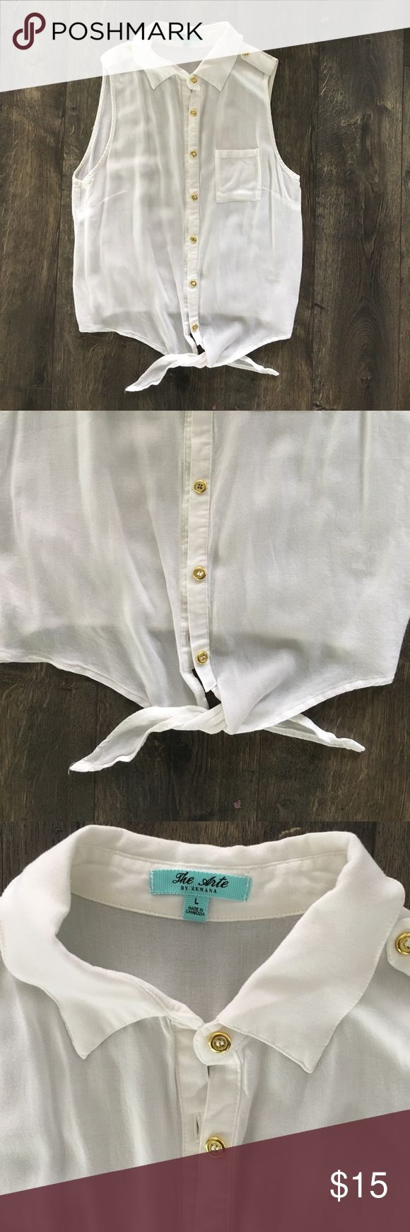 White sleeveless blouse with gold buttons Perfect summer shirt! Button up sleeveless blouse with gold buttons and tie at bottom. Fits more like a medium Tops Button Down Shirts