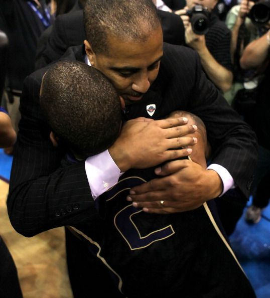 Head coach Lorenzo Romar of the Washington Huskies celebrates with Isaiah Thomas after the Huskies defeated the Arizona Wildcats 7775 in the...