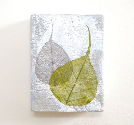 Small, contemplative mixed media 3D wall art -- reclaimed wood painted and collaged with mulberry paper and two hand painted bodhi leaf skeletons. Cool white, silver and warm yellow-green.  4 3/8 wide x 5 3/4 high x 1 7/8 deep (11.1 cm wide x 14.6 cm high x 4.8 cm deep)  Ready to hang with a sawtooth hanger installed on the back.