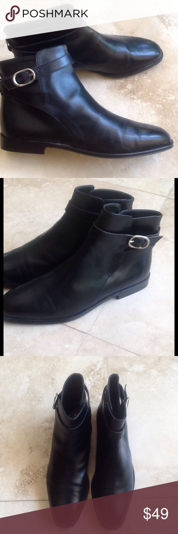 Joan & David Couture Boots NWOT Made in Italy .... Ankle black leather boots. Heel height is 3/4 inch. Silver buckle on side of each boot. Never worn out side of store. Classic tailored look. Joan & David Couture Shoes Ankle Boots & Booties