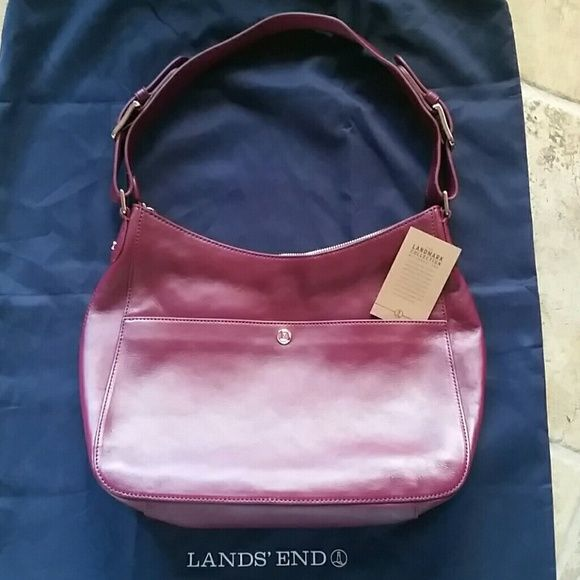 Lands End Landmark Collection Purse EUC Wine colored gold hardware but looks silver in different lighting. Leather and in very good condition. Carried a handful of times. Slight indentations from storing but not a noticeable thing. Only typical with leather goods and more than likely arrived this way from store but I want to describe as best I can. Storage bag not included. Lands' End Bags Hobos