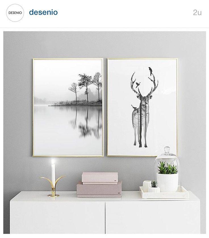 Pene bilder i gullramme på grå vegg