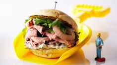 This amazing sandwich is stacked with tender, thinly-sliced Prime Rib nestled in a toasty warm bun along with grilled onions and arugula aioli.