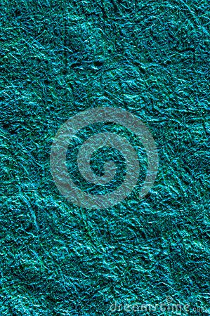 Blue aqua shiny plastic fiber background texture macro.
