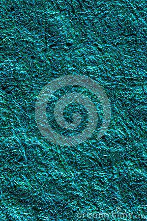 Blue aqua shiny plastic fiber background texture macro.