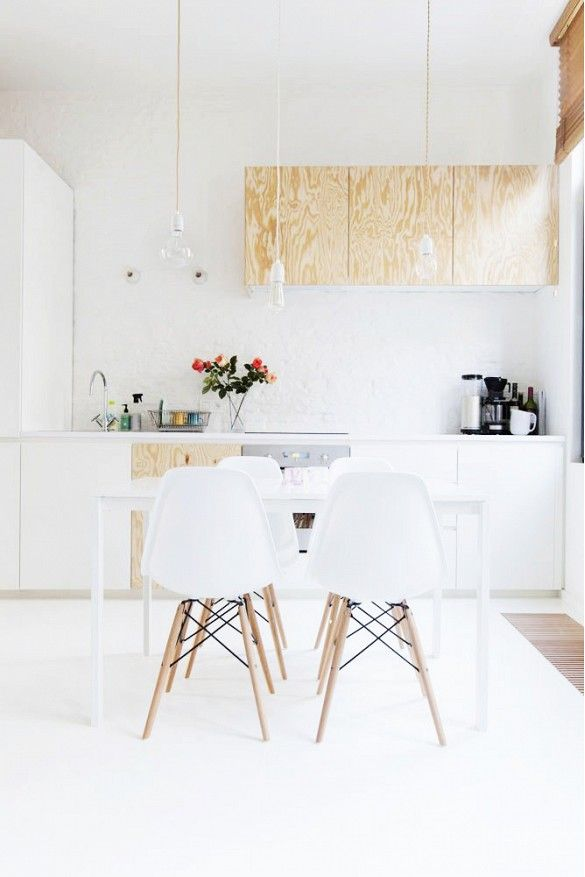 White kitchen with raw wood cabinets